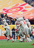 Ohio State players congratulate safety Tyvis Powell (23) after he intercepted a pass from Notre Dame Fighting Irish quarterback DeShone Kizer (14) during the third quarter of the Battlefrog Fiesta Bowl at University of Phoenix Stadium in Glendale, Arizona on Jan. 1, 2016. (Adam Cairns / The Columbus Dispatch)