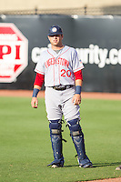 Spencer Kieboom (20) of the Hagerstown Suns warms up in the outfield prior to the game against the Greensboro Grasshoppers at NewBridge Bank Park on June 21, 2014 in Greensboro, North Carolina.  The Grasshoppers defeated the Suns 8-4. (Brian Westerholt/Four Seam Images)