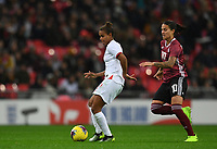9th November 2019; Wembley Stadium, London, England; International Womens Football Friendly, England women versus Germany women; Nikita Parris of England brings the ball forward under pressure from Dzsenifer Marozsan of Germany - Editorial Use