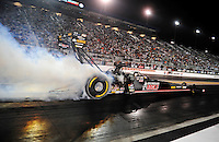Sept. 17, 2010; Concord, NC, USA; NHRA top fuel dragster driver Doug Kalitta does a burnout during qualifying for the O'Reilly Auto Parts NHRA Nationals at zMax Dragway. Mandatory Credit: Mark J. Rebilas/