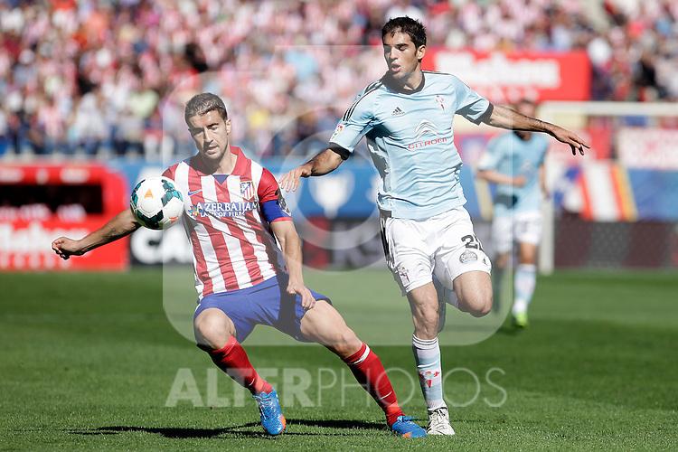 Atletico de Madrid´s Gabi (L) and Celta de Vigo´s Toni (R)during La Liga 2013/14 match. October 06, 2013. (ALTERPHOTOS/Victor Blanco)