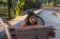 INDIA Karnataka Taccode, woman read newspaper Times of India / INDIEN Frau liest Zeitung Times of India
