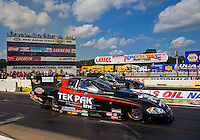 Aug 15, 2014; Brainerd, MN, USA; NHRA funny car driver Dale Creasy Jr (near lane) races alongside Brian Stewart during qualifying for the Lucas Oil Nationals at Brainerd International Raceway. Mandatory Credit: Mark J. Rebilas-