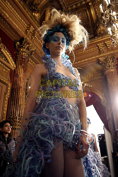 MODEL.Haute Couture. Yumi Katsura Spring & Summer Collection..January 25th, 2005.fashion show, blue, half length, string dress.www.capitalpictures.com.sales@capitalpictures.com.© Capital Pictures.