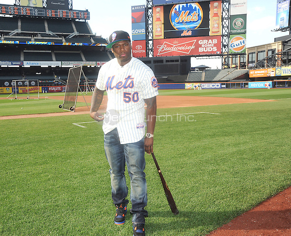 New York, NY- May 27:  Curtis &quot;50Cent&quot; Jackson poses on the field before he throws out the first pitch at the New York Mets-Pittsburgh Pirates game at Citi Field on May 27, 2014 in support of his upcoming post-game concert at Citi-Field in Flushing, New York. <br /> Credit: John Palmer/MediaPunch