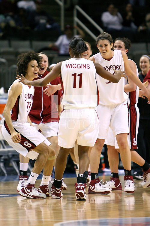 4 March 2007: Cissy Pierce, Clare Bodensteiner, and Brooke Smith congratulate Candice Wiggins during Stanford's 67-52 win over USC at the Pac-10 women's basketball tournament at HP Pavilion in San Jose, CA.