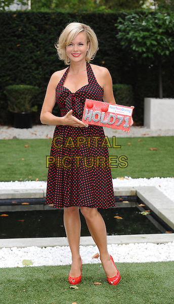 Amanda Holden.Photocall for Vodafone JustTextGiving Charity Challenges, London, England..5th September 2011.full length black red dress polka dot halterneck peep toe shoes sign.CAP/WIZ.© Wizard/Capital Pictures.