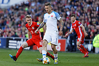 (L-R) Matthew Smith of Wales and Juraj Kucka of Slovakia in action during the UEFA EURO 2020 Qualifier match between Wales and Slovakia at the Cardiff City Stadium, Cardiff, Wales, UK. Sunday 24 March 2019