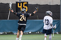 Washington, DC - February 23, 2019: Towson Tigers Brendan Sunday (24) celebrates after scoring a goal during game between Towson and Georgetown at  Cooper Field in Washington, DC.   (Photo by Elliott Brown/Media Images International)