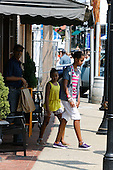 "United States President Barack Obama, with daughters Sasha and Malia, departs the Bunch of Grapes bookstore in Vineyard Haven on Friday, August 20, 2010.  It is reported the President purchased a copy of the book ""Freedom"" by Jonathan Franzen..Credit: Michael J. Maloney-Pool via CNP."