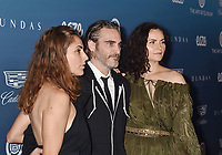 LOS ANGELES, CA - JANUARY 05: (L-R) Summer Phoenix, Joaquin Phoenix and Rain Phoenix attend Michael Muller's HEAVEN, presented by The Art of Elysium at a private venue on January 5, 2019 in Los Angeles, California.<br /> CAP/ROT/TM<br /> ©TM/ROT/Capital Pictures