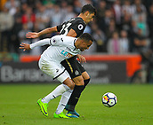 10th September 2017, Liberty Stadium, Swansea, Wales; EPL Premier League football, Swansea versus Newcastle United; Martin Olsson of Swansea City and Mikel Merino of Newcastle United battle for possession during the match