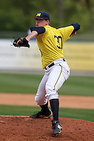 March 21, 2010:  Pitcher Matt Gerbe (30) of the Michigan Wolverines delivers a pitch during a game at Tradition Field in St. Lucie, FL.  Photo By Mike Janes/Four Seam Images