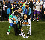 Keylor Navas of Real Madrid and his family with the trophy during the Champions League Final match at the Millennium Stadium, Cardiff. Picture date: June 3rd, 2017.Picture credit should read: David Klein/Sportimage