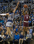Little Rock guard Rayjon Tucker (3) shoots over Nevada' Cody Martin (11) in the first half of an NCAA college basketball game in Reno, Nev., Friday, Nov. 16, 2018. (AP Photo/Tom R. Smedes)