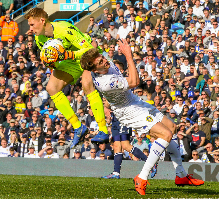 Leeds United's Patrick Bamford vies for possession with Millwall's David Martin<br /> <br /> Photographer Alex Dodd/CameraSport<br /> <br /> The EFL Sky Bet Championship - Leeds United v Millwall - Saturday 30th March 2019 - Elland Road - Leeds<br /> <br /> World Copyright © 2019 CameraSport. All rights reserved. 43 Linden Ave. Countesthorpe. Leicester. England. LE8 5PG - Tel: +44 (0) 116 277 4147 - admin@camerasport.com - www.camerasport.com