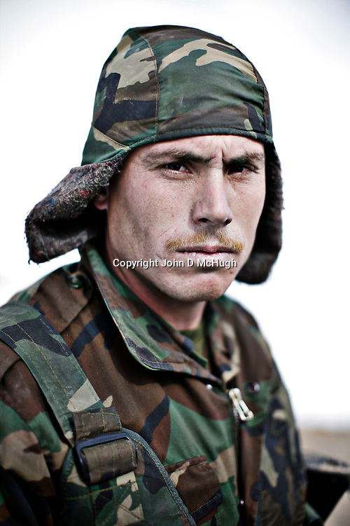 Afghan National Army (ANA) soldiers are seen training at Kabul Military Training Centre in Kabul, 13 February 2010. The KMTC is currently training 5,200 soldiers per month in a drive to build the Afghan National Army numbers up to the target of 134,000 soldiers by Oct 2010. (John D McHugh)