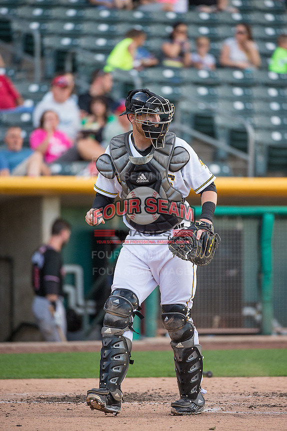 Jett Bandy (27) of the Salt Lake Bees on defense against the Albuquerque Isotopes in Pacific Coast League action at Smith's Ballpark on June 8, 2015 in Salt Lake City, Utah.  (Stephen Smith/Four Seam Images)