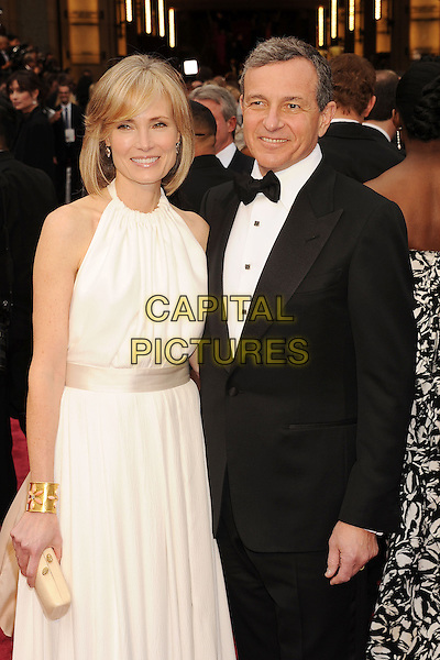 HOLLYWOOD, CA- MARCH 02: Robert Iger, Chairman &amp; CEO of The Walt Disney Company, and wife Willow Bay the 86th Annual Academy Awards held at Hollywood &amp; Highland Center on March 2, 2014 in Hollywood, California.<br /> CAP/ROT/TM<br /> &copy;Tony Michaels/Roth Stock/Capital Pictures