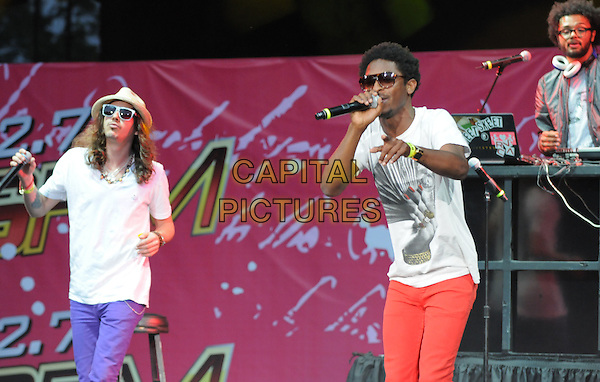 SCHWAYZE & CISCO ADLER.Live at The KIIS Fm Wango Tango 2008 held at The Verizon Wireless Ampitheatre in Irvine, California, USA, May 10th 2008..music concert gig on stage half length purple jeans red white hat sunglasses t-shirt .CAP/EAS.©Eastman/Capital Pictures