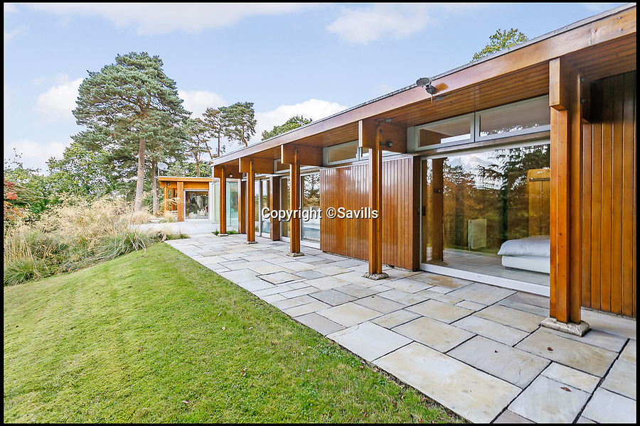 BNPS.co.uk (01202 558833)<br /> Pic: Savills/BNPS<br /> <br /> The 60 year old home still looks very modern...<br /> <br /> Perfect home for a Bond villan...designed by a Bond villan!<br /> <br /> This stunning 1960's modernist masterpiece near Windlesham in Surrey was actually designed by Hungarian architect Erno Goldfinger - who bizarrely author Ian Fleming had based one of his most notorious James Bond villans on.<br /> <br /> Fleming was furious with Goldfinger after the architect had demolished his Hampstead cottage to make way for a modernist development before the war.<br /> <br /> But at £3 million you may need your own gold reserves to afford the stunning grade two listed home, and with 4 acres of grounds an 'Oddjob' man may come in handy to look after it.
