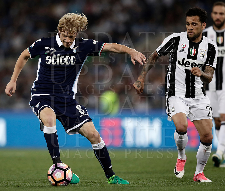 Calcio, Tim Cup: finale Juventus vs Lazio. Roma, stadio Olimpico, 17 maggio 2017.<br /> Lazio's Dusan Basta, left, is chased by Juventus' Dani Alves during the Italian Cup football final match between Juventus and Lazio at Rome's Olympic stadium, 17 May 2017.<br /> UPDATE IMAGES PRESS/Isabella Bonotto