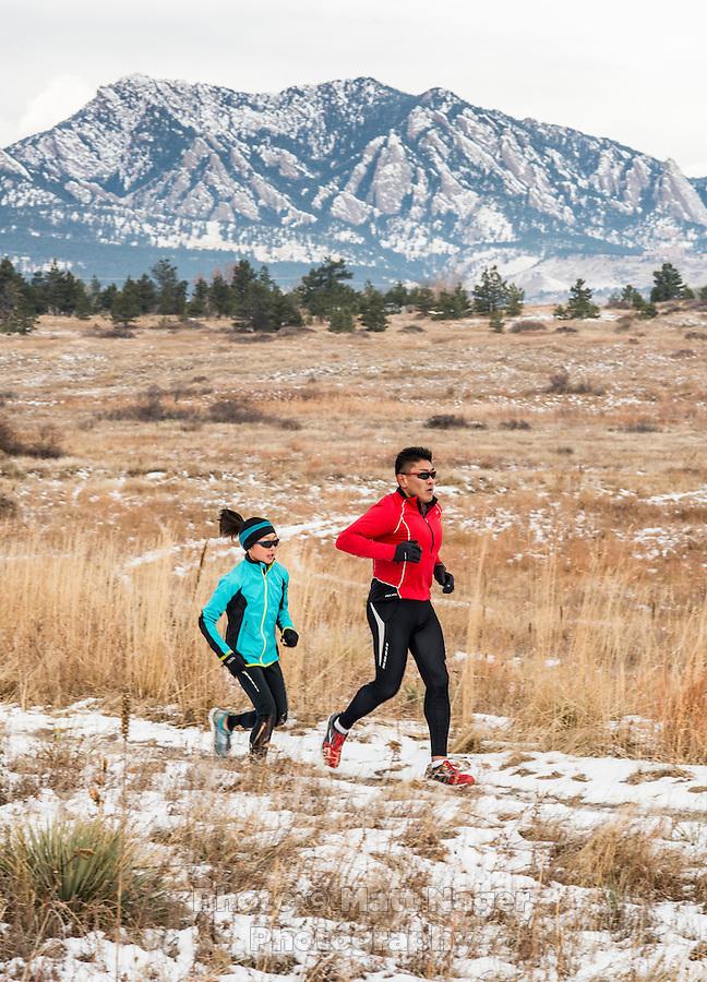 Runners Yusuke Kirimoto and his daughter Sara Kirimoto (age 10) run along the Marshall Mesa Trail in Boulder, Colorado, Saturday, December 10, 2016. Inspired by his daughter, Yusuke has lost over 100lbs through running. <br /> <br /> Photo by Matt Nager