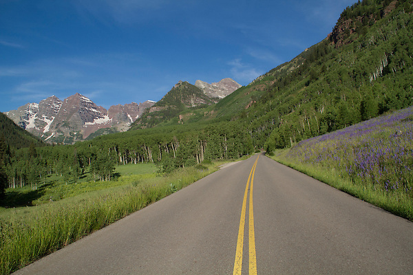 Mountain road leading to the Maroon Bells, west of Aspen, Colorado, John offers fall foliage photo tours throughout Colorado.