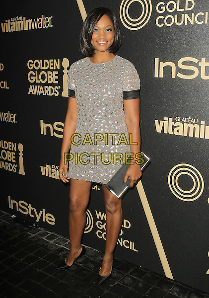 Garcelle Beauvais.The Hollywood Foreign Press Association And InStyle Miss Golden Globe 2013 Party held at Cecconi's Restaurant, West Hollywood, California, USA, 29th November 2012..full length grey gray dress silver polka dots clutch bag .CAP/ADM/KB.©Kevan Brooks/AdMedia/Capital Pictures.