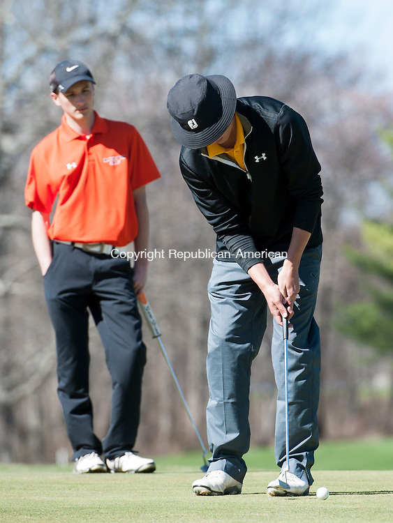 WATERTOWN, CT-28 April 2015-042815EC08-  Holy Cross' Preston Shortell putts Tuesday afternoon at Crestbrook Park Golf Course in Watertown. Erin Covey Republican-American
