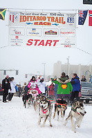 DeeDee Jonrowe and team leave the ceremonial start line at 4th Avenue and D street in downtown Anchorage during the 2013 Iditarod race. Photo by Jim R. Kohl/IditarodPhotos.com