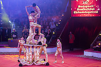 Members of the Quingdao Troupe of China perform their foot juggling act during the 10th International Circus Festival in Budapest, Hungary on January 13, 2014. ATTILA VOLGYI