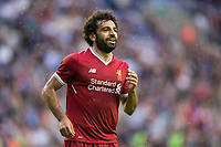 Mohamed Salah of Liverpool celebrates his first goal for the club on his debut on the 45th minute during the pre season friendly match between Wigan Athletic and Liverpool at the DW Stadium, Wigan, England on 14 July 2017. Photo by Andy Rowland.
