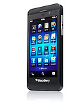 Blackberry Z10 smartphone standing at an angle. Black phone isolated on white background with clipping path