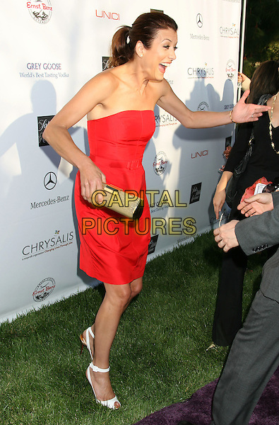 KATE WALSH.7th Annual Chrysalis Butterfly Ball held at a Private Residence, Los Angeles, California, USA,.31 May 2008..full length red strapless dress funny clutch bag Christian Louboutin.CAP/ADM/MJ.©Michael Jade/Admedia/Capital Pictures