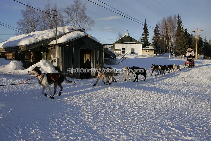 Ramy Brooks team runs down the road as he leaves the Nikolai checkpoint.  2005 Iditarod Trail Sled Dog Race.
