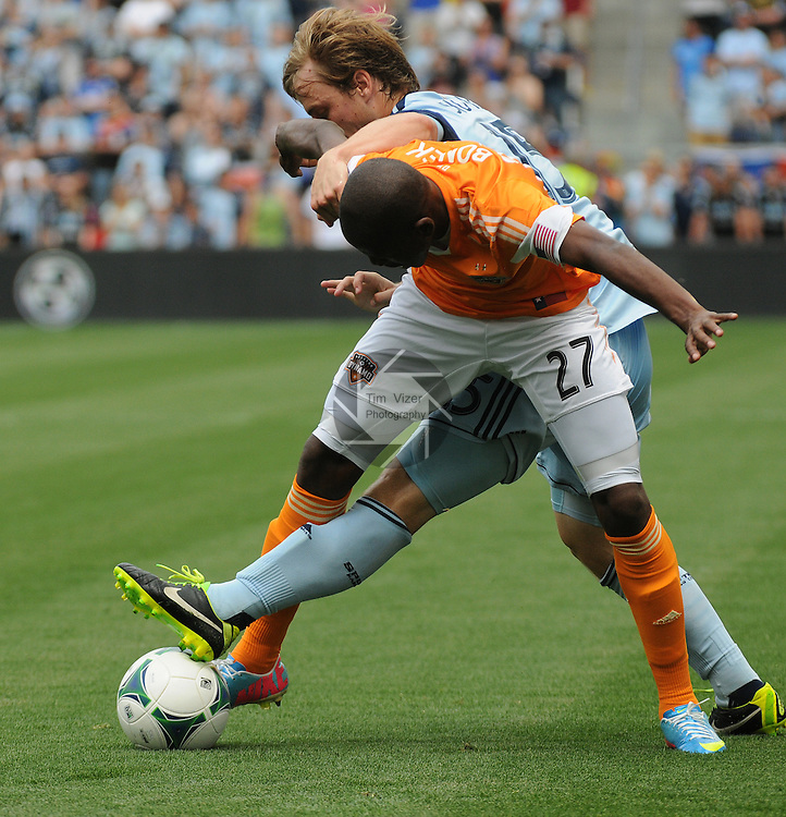 Football - Major League Soccer - Houston Dynamo at Sporting KC - The Sporting KC and the Houston Dynamo played to a 1-1 tie in regulation time at Sporting KC Park in Kansas City, Kansas, USA. Houston Dynamo midfielder Boniek Garcia (27) and Sporting KC defender Seth Sinovic (15) fight for the ball in the first half.