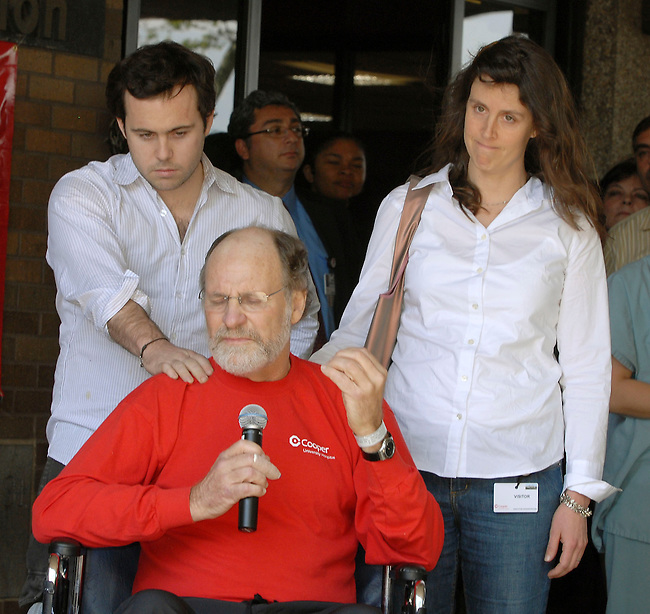 New Jersey Gov. Jon Corzine, center, joined by his children Jeffery, left and Jennifer, right, reacts as he addresses the media following his  released form the Cooper Hospital Monday, April, 30, 2007 in Camden, NJ. Corzine was hospitalized for several weeks with severe injuries following a high speed crash of his state vehicle while not wearing a seat belt. (Bradley C Bower/Bloomberg News)