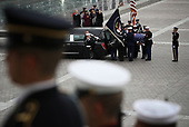 A U.S. military honor guard team places the flag draped casket of former U.S. President George H. W. Bush into a hearse on the east plaza of the U.S. Capitol December 5, 2018 in Washington, DC. A funeral service will be held today for former U.S. President H.W. Bush at the Washington National Cathedral. President Bush will be buried at his final resting place at the George H.W. Bush Presidential Library at Texas A&M University in College Station, Texas. A WWII combat veteran, Bush served as a member of Congress from Texas, ambassador to the United Nations, director of the CIA, vice president and 41st president of the United States. <br /> Credit: Win McNamee / Pool via CNP