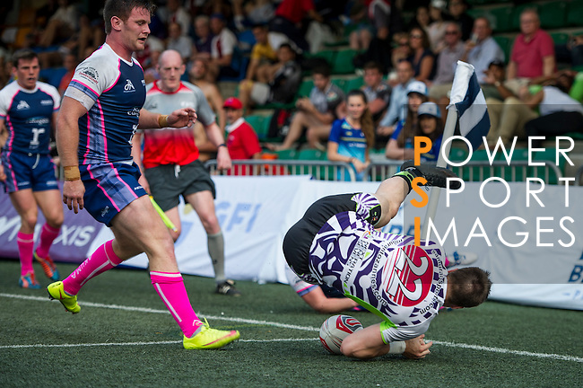 Samurai International (in white) plays against Projecx Waterboys (in blue) during GFI HKFC Rugby Tens 2016 on 06 April 2016 at Hong Kong Football Club in Hong Kong, China. Photo by Juan Manuel Serrano / Power Sport Images