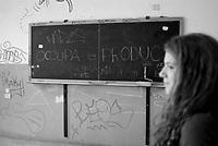 Milano, occupazione e autogestione del Liceo Artistico Statale di Brera per protestare contro la riforma dell'istruzione. Lavagna con la scritta Occupa e prodici --- Milan, occupation and self-management of an art high school as a protest against the school reform. Blackboard with the writing Occupy and produce