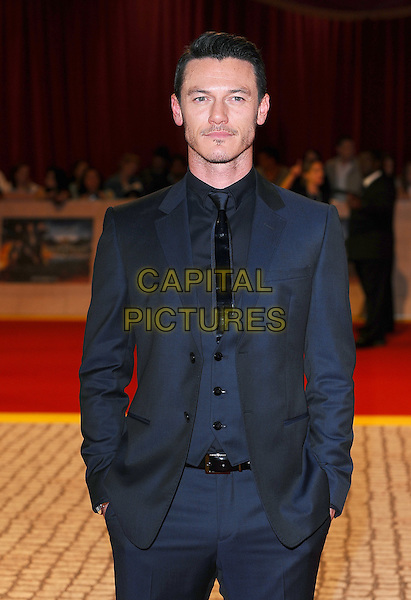 Luke Evans.'The Three Musketeers in 3D' world film premiere, Vue cinema, Westfield, London, England. 4th October 2011.half length blue black suit jacket shirt hands in pockets facial hair moustache mustache waistcoat .CAP/BEL.©Tom Belcher/Capital Pictures.