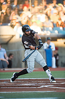Salem-Keizer Volcanoes first baseman Robinson Medrano (7) swings at a pitch during a Northwest League game against the Hillsboro Hops at Ron Tonkin Field on September 1, 2018 in Hillsboro, Oregon. The Salem-Keizer Volcanoes defeated the Hillsboro Hops by a score of 3-1. (Zachary Lucy/Four Seam Images)