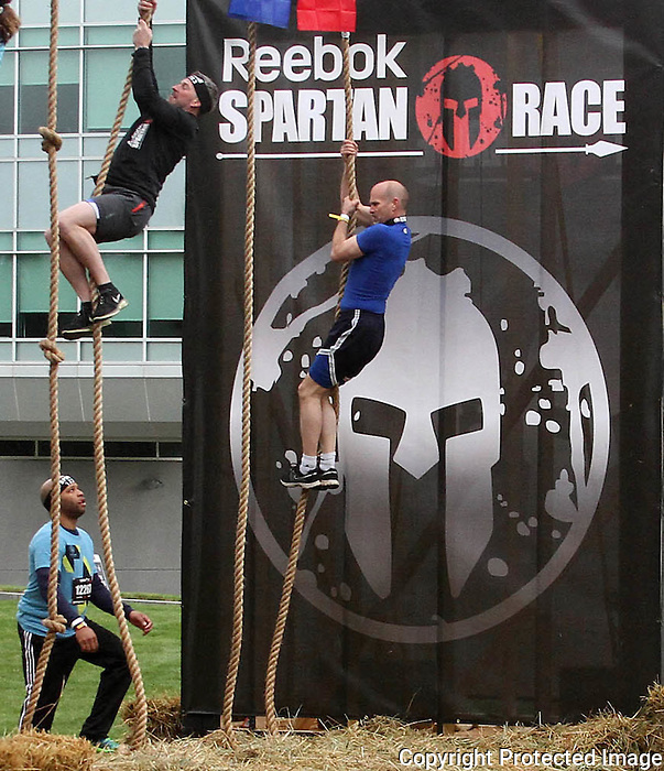 Competitors climbs ropes at the Reebok Spartan Race Invitational at Reebok Headquarters in Canton on Sunday April 27, 2014.(Photo by Gary Wilcox)