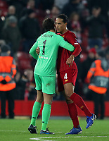 5th November 2019; Anfield, Liverpool, Merseyside, England; UEFA Champions League Football, Liverpool versus Genk; Liverpool goalkeeper Alisson embraces Virgil van Dijk after the match ends with a 2-1 win for Liverpool  - Editorial Use