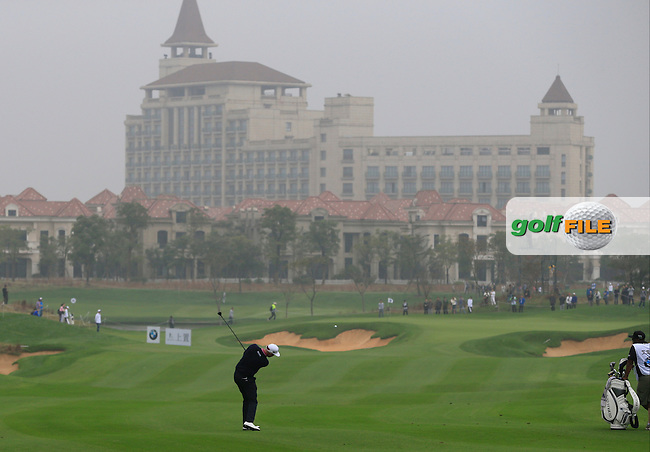 Mikko Ilonen (FIN) plays his 2nd shot on the 5th hole during Saturay's Round 3 of the 2014 BMW Masters held at Lake Malaren, Shanghai, China. 1st November 2014.<br /> Picture: Eoin Clarke www.golffile.ie