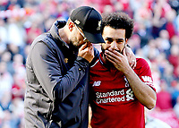 Liverpool manager Jurgen Klopp converses with Mohamed Salah at the final whistle<br /> <br /> Photographer Rich Linley/CameraSport<br /> <br /> The Premier League - Liverpool v Wolverhampton Wanderers - Sunday 12th May 2019 - Anfield - Liverpool<br /> <br /> World Copyright © 2019 CameraSport. All rights reserved. 43 Linden Ave. Countesthorpe. Leicester. England. LE8 5PG - Tel: +44 (0) 116 277 4147 - admin@camerasport.com - www.camerasport.com