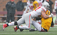 Ohio State Buckeyes defensive lineman Joey Bosa (97) takes down Minnesota Golden Gophers quarterback Mitch Leidner  in the first quarter at TCF Bank Stadium on November 15, 2014. (Chris Russell/Dispatch Photo)