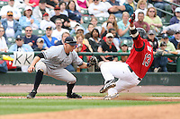 June 1st 2008:  Third baseman Cody Ransom (3) of the Scranton Wilkes-Barre Yankees, Class-AAA affiliate of the New York Yankees, tags out Randy Ruiz (13) of the Rochester Red Wings during a game at Frontier Field in Rochester, NY.  Photo By Mike Janes/Four Seam Images
