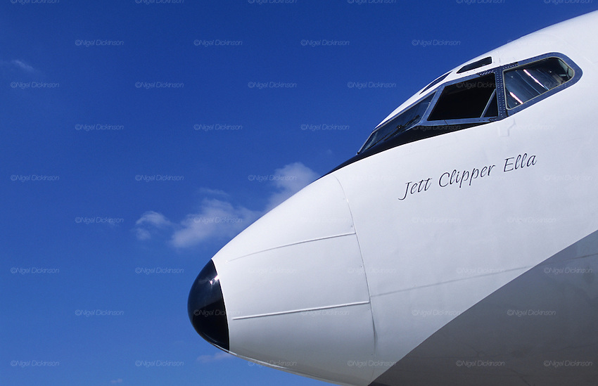 """Jett Clipper Ella""  name of John Travolta's jumbo jet...John Travolta is pilot of his very own jumbo jet, a 1964 Boeing 707-100 series. In 2003, John Travolta flew his jumbo jet around the world, in partnership with Quantas, to rekindle confidence in commercial aviation, and to remind us that elegance and style are a part of flying. The crew are dressed in tailor made authentic uniforms from the Quantas museum. The men's uniforms are styled on British Naval uniforms and the ladies' designed by Chanel. His jumbo jet sports a personalised number plate N707JT which speaks for itself. The aircraft is named ""Jett Clipper Ella"" dedicated to his son and daughter. This jumbo together with his other aircraft are housed in purpose built hangars at his home in Florida, USA."